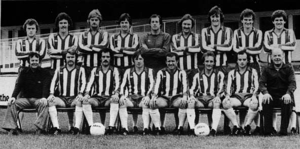 Wigan Athletic 1978/1979 Back Row: Kevin Smart, Peter Houghton, Neil Davids, Geoff Gay, John Brown, Frank Corrigan, Noel Ward, Joe Hinningan, Jeff Wright Front Row: Ian McNeill (Manager), Alan Crompton, Ian Seddon, Tommy Gore, Ian Gillibrand (captain), John Wilkie, Ian Purdie, Kenny Banks (Trainer)