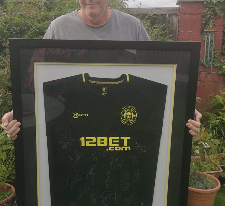 £600k reached and win a framed signed FA Cup winning shirt